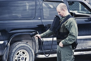 EOMAX Security Professional Checking Vehicles with Infrared Imaging
